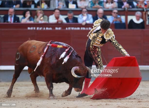 Spanish matador Gines Marin performs a pass on a bull during the San Isidro bullfight festival at Las Ventas bullring in Madrid on May 25 2017 / AFP...