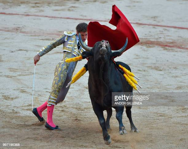 Spanish matador Gines Marin performs a pass to a Victoriano del Rio fighting bull during a bullfight of the San Fermin festival in Pamplona northern...