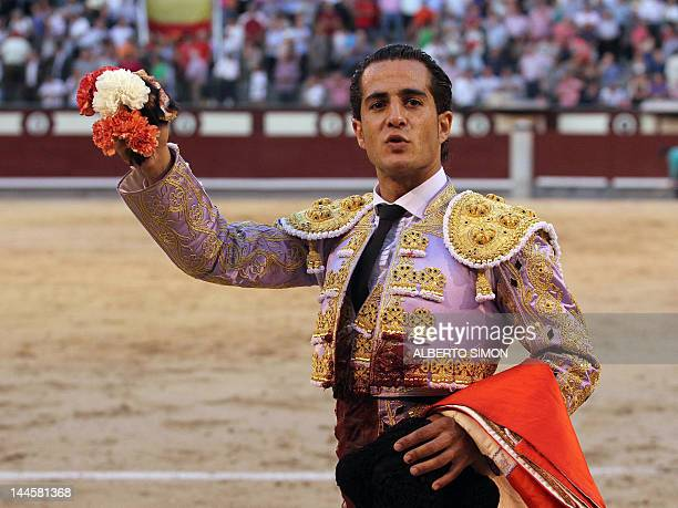 Spanish matador Ivan Fandino celebrates after cutting a bull's ear at the Las Ventas bullring during the San Isidro Feria on May 16 2012 in Madrid...