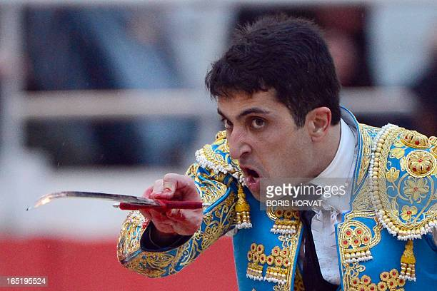 Spanish matador Javier Castano prepares to kill a Spanish Victorino Martin bull during the spring feria on April 1 2013 in Arles southern France AFP...