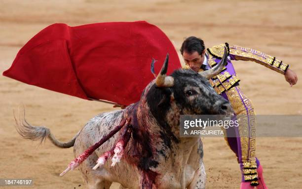 Spanish matador Javier Sanchez gives a pass with muleta to his Cebada Gago fighting bull during the second corrida of the San Fermin festivities on...