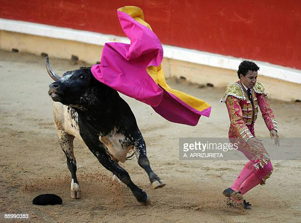 Spanish matador Jesus Millan gives a pass to a bull during a bullfight of the San Fermin festival on July 12 in Pamplona northern Spain AFP PHOTO / A...