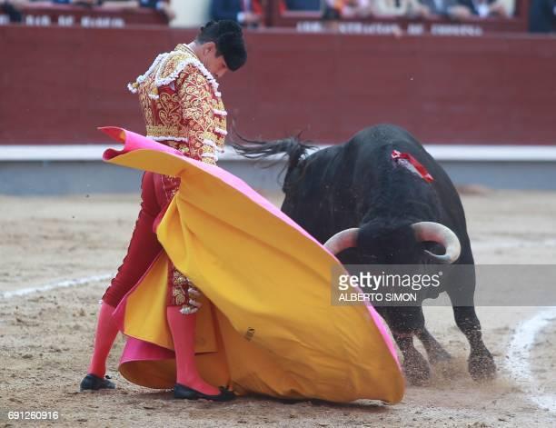 Spanish matador Jose Maria Manzanares performs a pass during the San Isidro bullfight festival at Las Ventas bullring in Madrid on June 1 2017 / AFP...