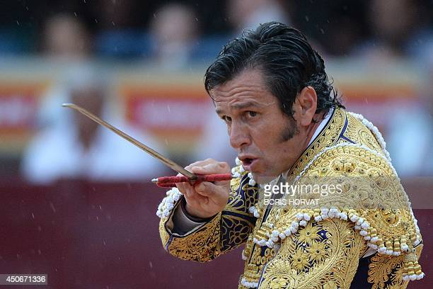 Spanish matador Jose Miguel Arroyo also known as Joselito holds a little sword also known as verdugo at the end of his fight with a Garcigrande...