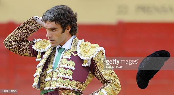 Spanish matador Jose Tomas throws his montera during a bullfight of the San Antolin festivities at the Palencia bullring on September 2 2009 AFP...