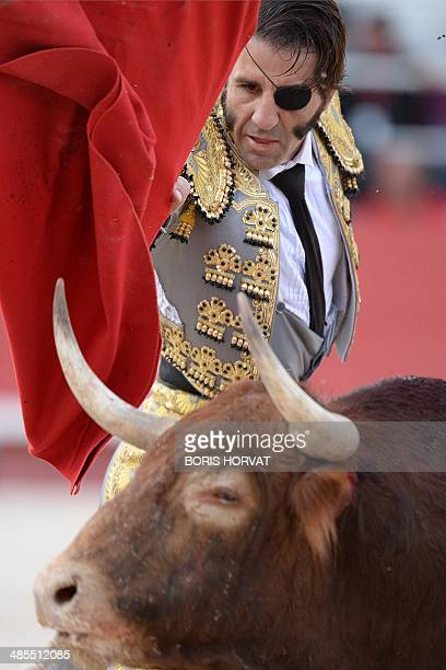 Spanish matador Juan Jose Padilla performs a pass on a Spanish José Luis Pereda bull during the spring feria on April 18 2014 in Arles southern...