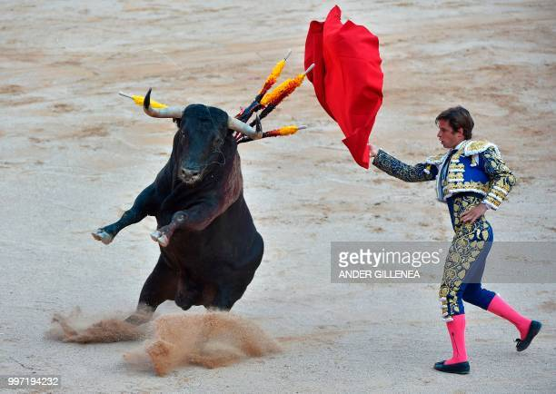 Spanish matador Julian Lopez 'El Juli' performs a pass to a Victoriano del Rio fighting bull during a bullfight of the San Fermin festival in...