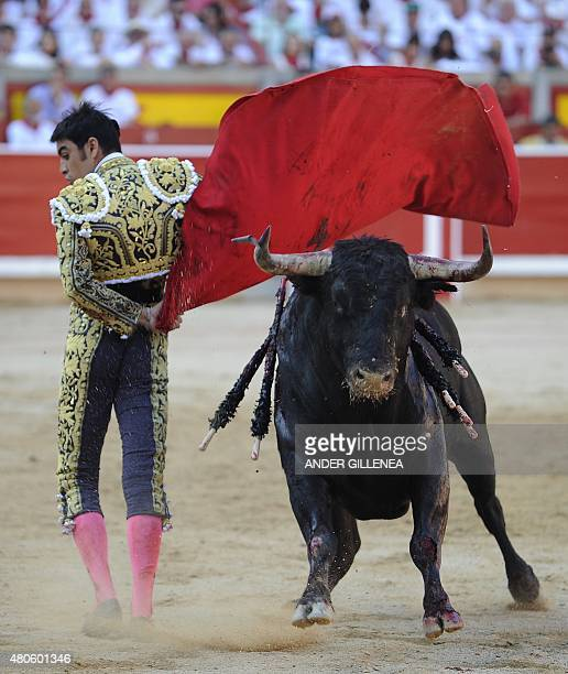 Spanish matador Miguel Angel Perera peforms a pass to a Garcigrande D Domingo Hernandez Martin's bull during the seventh corrida of the San Fermin...