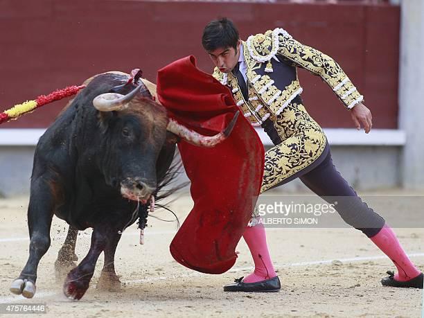 Spanish matador Miguel Angel Perera performs performs a pass on a during the San Isidro bullfight festival at Las Ventas bullring in Madrid on May 13...