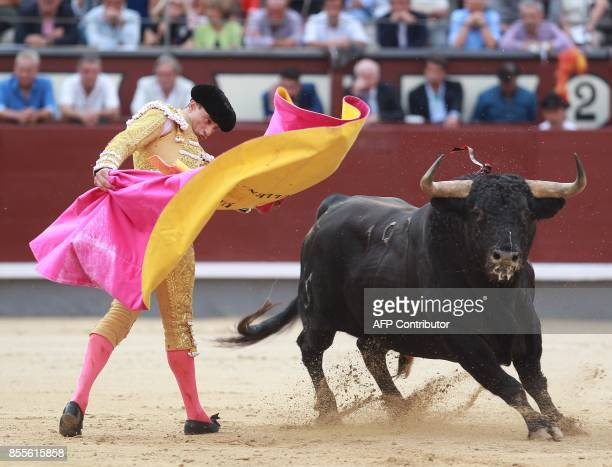 Spanish matador Paco Urena performs a pass on a bull during the Fall bullfighting festival at Las Ventas bullring in Madrid on September 29 2017 /...
