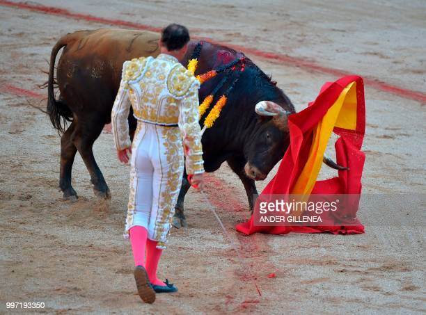 Spanish matador Pepin Liria eyes a Victoriano del Rio fighting bull during a bullfight of the San Fermin festival in Pamplona northern Spain on July...