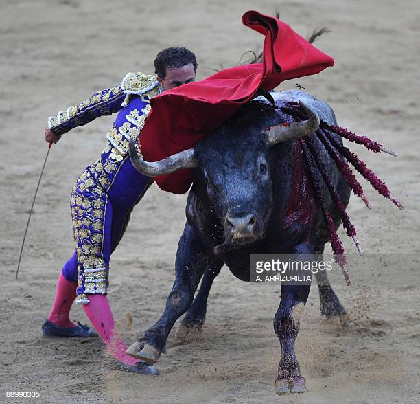 Spanish matador Rafael Rubio 'Rafaelillo' gives a pass to a bull during a bullfight of the San Fermin festival on July 12 in Pamplona northern Spain...