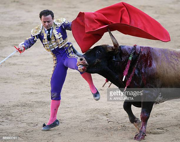 Spanish matador Rafael Rubio 'Rafaelillo' is gored by a bull during a bullfight of the San Fermin festival on July 12 in Pamplona northern Spain AFP...
