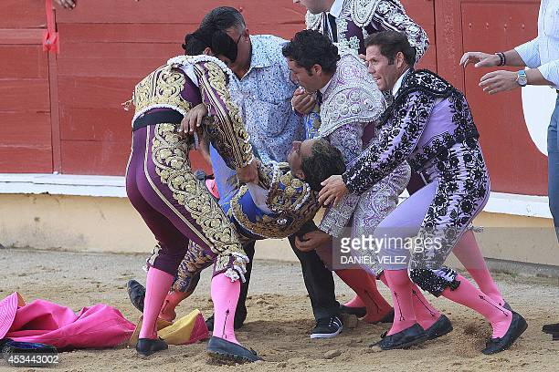 Spanish matador Yvan Fandino is carried out of the arena after being injured by a bull during his bullfight held as part of the August feria in...