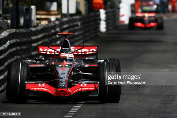 Spanish McLaren Formula One driver Fernando Alonso driving his McLaren MP4-22 car leads his British teammate Lewis Hamilton during the 2007 Monaco...