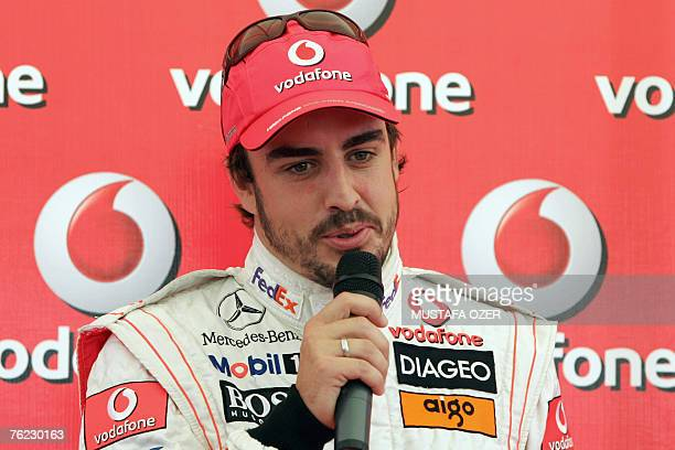 Spanish McLaren Mercedes Formula One driver Fernando Alonso talks to media during a promotional event as part of the Vodafone Gokart Cup 2007 in...