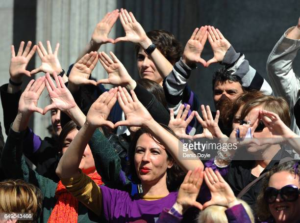 Spanish members of Parliament hold a protest against domestic violence outside Parliament during International Women's Day on March 8 2017 in Madrid...