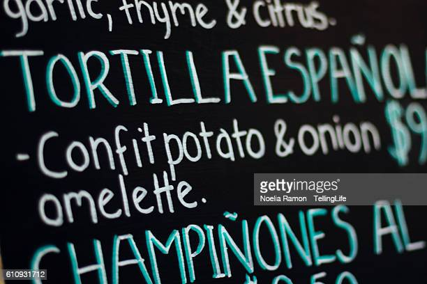 spanish menu: tortilla española, champiñones... - tortilla de patata fotografías e imágenes de stock