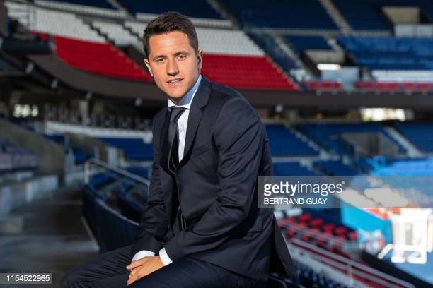 Spanish midfielder Ander Herrera poses after he signed a five-year contract with the Paris Saint-Germain football club at the Parc des Princes, in...