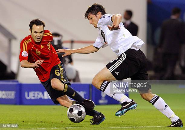 Spanish midfielder Andres Iniesta and German defender Arne Friedrich fight for the ball during the Euro 2008 championships final football match...