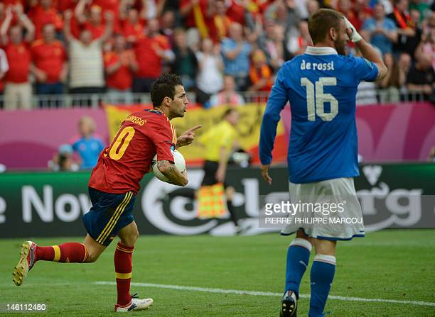 Spanish midfielder Cesc Fabregas celebrates after scoring during the Euro 2012 championships football match Spain vs Italy on June 10 2012 at the...