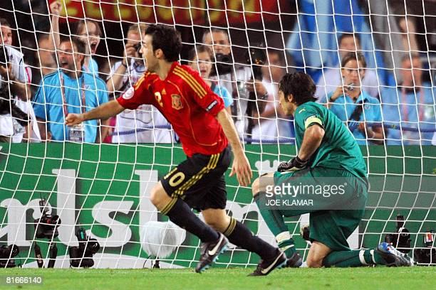Spanish midfielder Cesc Fabregas runs to celebrate after scoring the winning goal of the penalty shoot out against Italian goalkeeper Gianluigi...