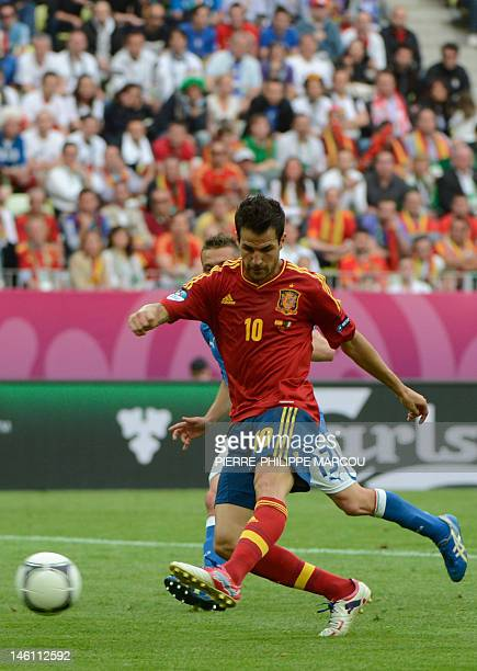 Spanish midfielder Cesc Fabregas scores during the Euro 2012 championships football match Spain vs Italy on June 10 2012 at the Gdansk Arena AFP...