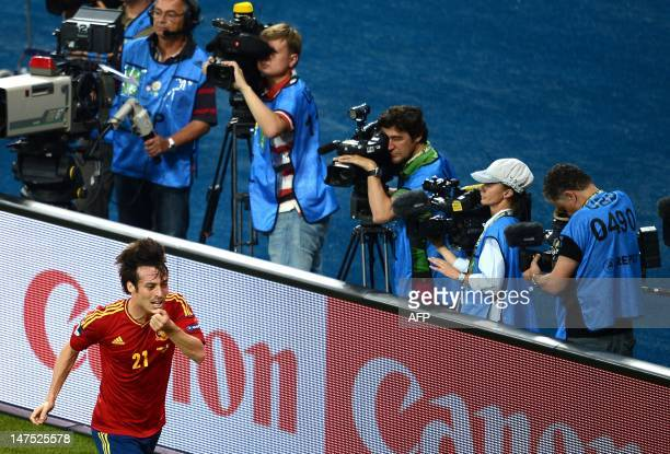 Spanish midfielder David Silva celebrates after scoring during the Euro 2012 football championships final match Spain vs Italy on July 1 2012 at the...