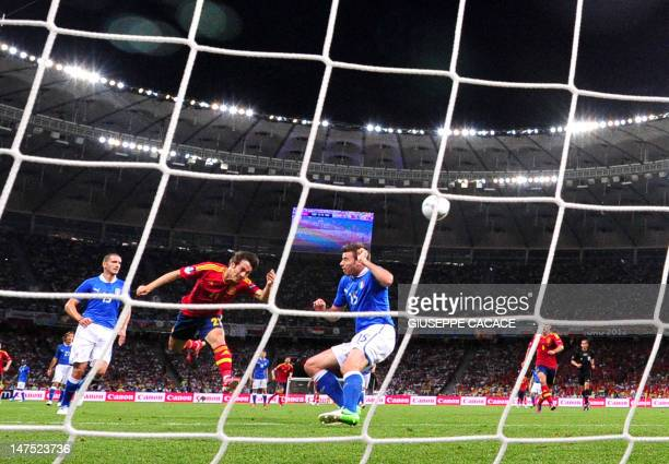 Spanish midfielder David Silva heads the ball to score during the Euro 2012 football championships final match Spain vs Italy on July 1, 2012 at the...