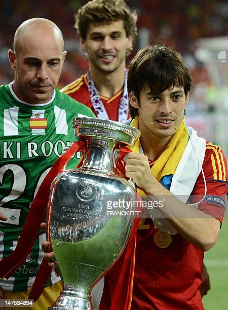 Spanish midfielder David Silva holds the trophy after winning the Euro 2012 football championships final match Spain vs Italy on July 1 2012 at the...