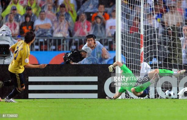 Spanish midfielder David Silva scores his team's third goal past Russian goalkeeper Igor Akinfeev during the Euro 2008 championships semifinal...