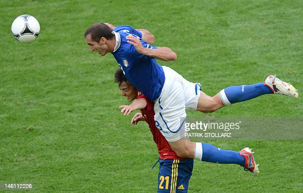 Spanish midfielder David Silva vies with Italian defender Giorgio Chiellini during the Euro 2012 championships football match Spain vs Italy on June...