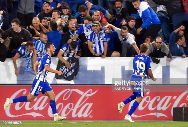 Spanish midfielder Manuel Alejandro celebrates scoring a goal with Alaves' Argentinian forward Calleri during the Spanish league football match...