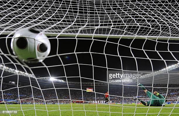 Spanish midfielder Marcos Senna scores against Italian goalkeeper Gianluigi Buffon in the penalty shootouts during the Euro 2008 Championships...