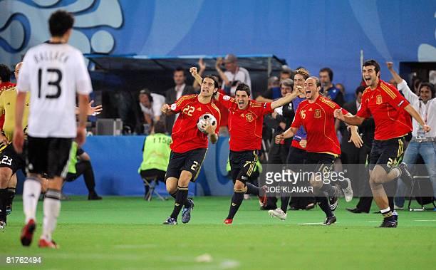 Spanish midfielder Ruben de La Red forwards David Villa and Sergio Garcia and defender Raul Albiol celebrate past German midfielder Michael Ballack...