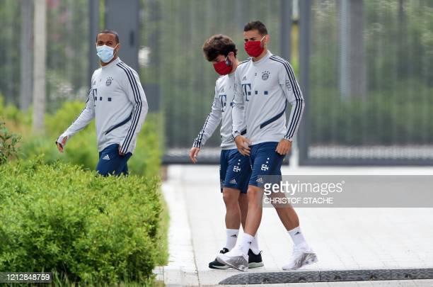 Spanish midfielder Thiago Alcantara, Spain defender Alvaro Odriozola and French defender Lucas Hernandez wear face masks as they arrive for a...