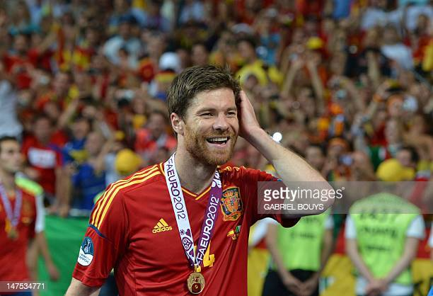 Spanish midfielder Xabi Alonso smiles after winning the Euro 2012 football championships final match Spain vs Italy on July 1 2012 at the Olympic...