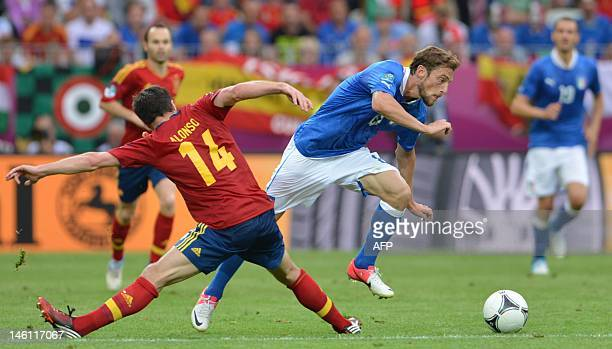 Spanish midfielder Xabi Alonso vies with Italian midfielder Claudio Marchisio during the Euro 2012 championships football match Spain vs Italy on...