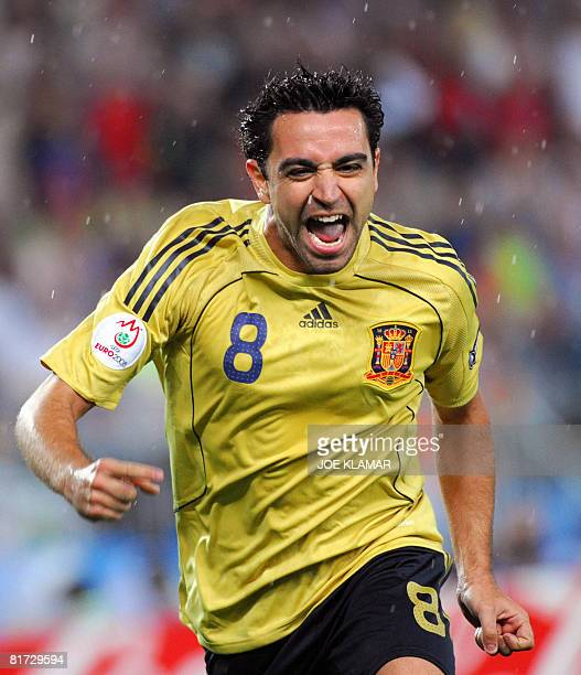 Spanish midfielder Xavi Hernandez celebrates after scoring the opening goal during the Euro 2008 championships semi-final football match Russia vs....