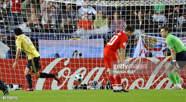 Spanish midfielder Xavi Hernandez runs off in celebration after scoring against Russian goalkeeper Igor Akinfeev during the Euro 2008 championships...
