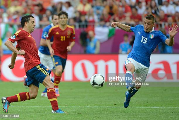 Spanish midfielder Xavi Hernandez vies with Italian midfielder Emanuele Giaccherini during the Euro 2012 championships football match Spain vs Italy...