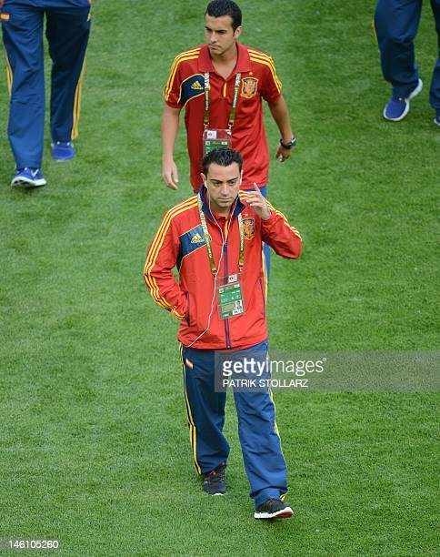 Spanish midfielder Xavi Hernandez walks on the pitch prior to the Euro 2012 championships football match Spain vs Italy on June 10 2012 at the Gdansk...