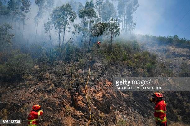 Spanish military firefighters from the Emergency Military Unit prepare to tackle a wildfire in Cernache de Bomjardim in Serta on June 20, 2017. The...