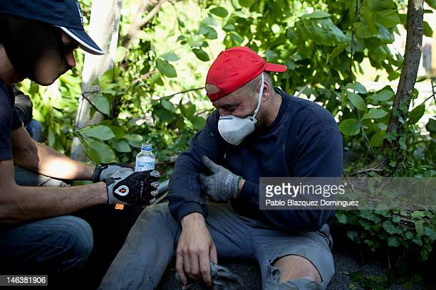 Spanish miner is treated for eye injuries after riot police launched tear gas at the Soton mine June 15 2012 in El Entrego near Oviedo in northern...