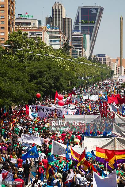 Spanish miners wave banners and shout slogans near the Kio towers headquarters of Bankia SA after marching from Asturias to the capital to protest...