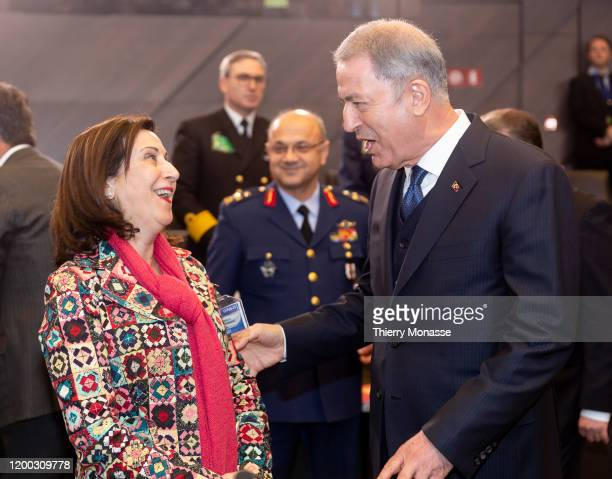 Spanish Minister of defense Margarita Robles Fernandez is talking with the Turkish Defense Minister Hulusi Akar during the first meeting of NATO...