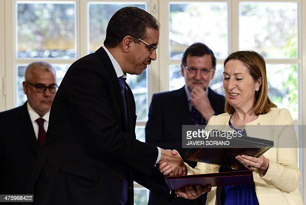 Spanish Minister of Health Social Services and Equality Ana Mato shakes hands with Moroccan Minister of Equipment Transport and Logistics Aziz Rabbah...