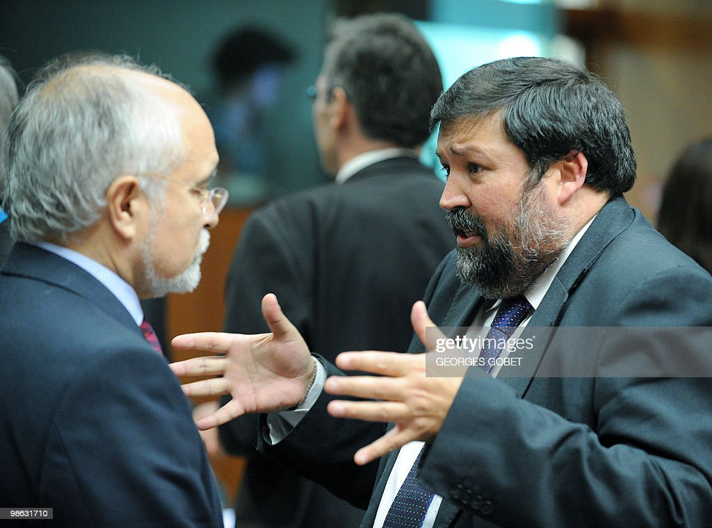 Spanish Minister of Justice Francisco Caamano Dominguez (R) and Portugues state secretary for the Interior Jose Magalhaes (L) talk prior of the Justice and Home Affairs Council meeting on April 23, 2010 at the EU headquarters in Brussels.