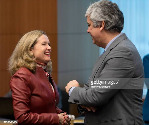 Spanish Minister of Minister of Economy, Industry and Competitiveness Nadia Calvino is talking with the Portuguese Finance Minister, President of the...
