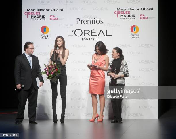 Spanish model Alejandra Alonso speaks after she was named Best Model at the L'Oreal Awards while Marta Fernandez and Cuca Solana listen during the...